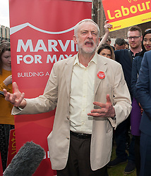 © Licensed to London News Pictures.07/05/2016. Bristol, UK.  JEREMY CORBYN , leader of the Labour Party, congratulates MARVIN REES, the Labour candidate for winning the Bristol Mayoral election at College Green, after leading in the election count on first preference votes by 56,729 to George Ferguson's 32,375. The Bristol Mayoral election was seen as a two horse race between the incumbent mayor George Ferguson and Labour's challenger Marvin Rees. Photo credit : Simon Chapman/LNP