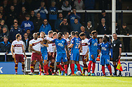 Bradford City forward Dominic Poleon and Peterborough United midfielder Anthony Grant amongst the players following a coming together during the EFL Sky Bet League 1 match between Peterborough United and Bradford City at London Road, Peterborough, England on 9 September 2017. Photo by Aaron  Lupton.