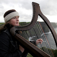 Tina Morrissey from Quilty who has being playing the harp at the Cliffs of Moher for over 20 years but who now faces eviction along with the other musicians by Clare County Council.<br /> <br /> Photograph by Yvonne Vaughan.