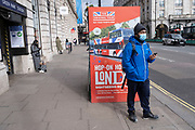 Face masks on Piccadilly as the national coronavirus lockdown three continues on 5th March 2021 in London, United Kingdom. With the roadmap for coming out of the lockdown has been laid out, this nationwide lockdown continues to advise all citizens to follow the message to stay at home, protect the NHS and save lives, and the streets of the capital are quiet and empty of normal numbers of people.