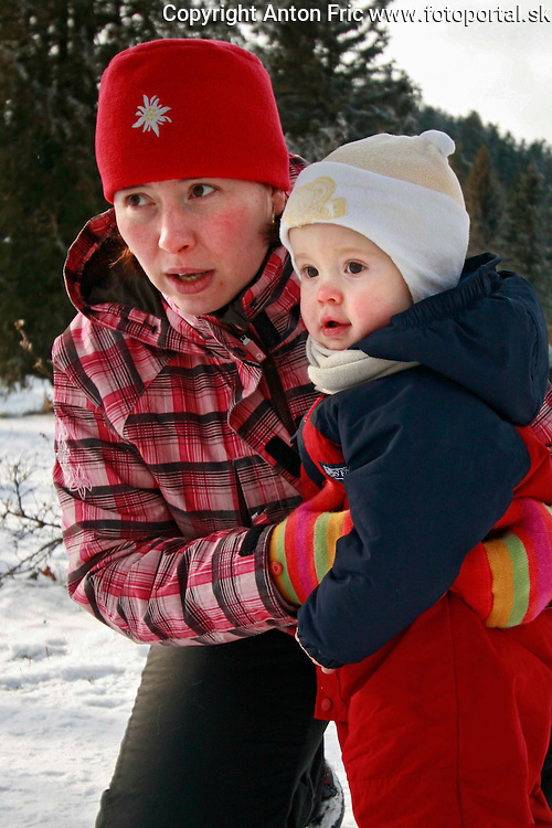 Pictures of a family from under High Tatra mountains taken during two sessions - one inside of their home and one outside, during sunny winter day.