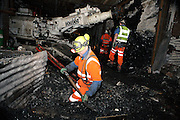 A miner is shovelling in front of the coal face inside Unity Mine while on his back stands the new USD 2.5 million excavator drill acquired by the company, on Tuesday, July 31, 2007, in Cwmgwrach, Vale of Neath, South Wales. The time is ripe again for an unexpected revival of the coal industry in the Vale of Neath due to the increasing prize and diminishing reserves of oil and gas, the uncertainties of renewable energy sources, and the technological advancement in producing energy from coal while limiting emissions of pollutants, has created the basis for valuable investment opportunities and a possible alternative to the latest energy crisis. Unity Mine, in particular, has started a pioneering effort to revive the coal industry in the area, reopening after more than 8 years with the intent of exploiting the large resources still buried underground. Coal could be then answer to both, access to cheaper and paradoxically greener energy and a better and safer choice than nuclear energy as a major supply for the decades to come. It is estimated that coal reserves in Wales amount to over 250 million tonnes, or the equivalent of at least 50 years of energy supply, while the worldwide total coal could last for over 200 years as a viable resource compared to only a few decades of oil and natural gas.