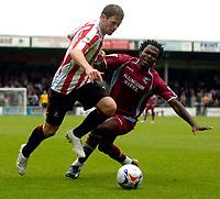 Photo: Jed Wee/Sportsbeat Images.<br /> Scunthorpe United v Sunderland. Pre Season Friendly. 21/07/2007.<br /> <br /> Sunderland's Daryl Murphy (L) takes on Scunthorpe's Kelly Youga.