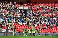 Forest Green Rovers players celebrate in front of the fans during the Vanarama National League Play Off Final match between Tranmere Rovers and Forest Green Rovers at Wembley Stadium, London, England on 14 May 2017. Photo by Adam Rivers.