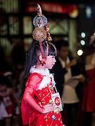 17 SEPTEMBER 2015 - BANGKOK, THAILAND: A participant in the Santa pageant walks the catwalk during the pageant at the World Santa Claus Congress. Twenty-six Santa Clauses from around the world are in Bangkok for the first World Santa Claus Congress. The World Santa Claus Congress has been an annual event in Denmark since 1957. This year's event, hosted by Snow Town, a theme park with a winter and snow theme, hosted the event. There were Santas from Japan, Hong Kong, the US, Canada, Germany, France and Denmark. They presented gifts to Thai children and judged a Santa pageant. Thailand, a Buddhist country, does not celebrate the religious aspects of Christmas, but Thais do celebrate the commercial aspects of the holiday.    PHOTO BY JACK KURTZ