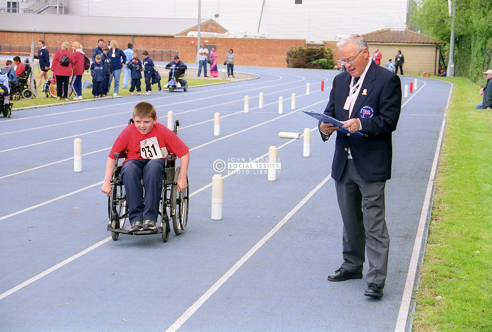 Young disabled boy taking part in Mini games sports event held at Stoke Mandeville Stadium,