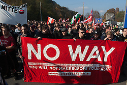 Licensed to London News Pictures. 31/10/2015. Spielfeld, Austria. Anti-migrant protest in Spielfeld, Austria. Protesters shout slogans during an anti-migrant protest. Photo: Marko Vanovsek/LNP
