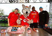 Kansas City events and business marketing photographer-<br /> Smithfield products, with Champion Pitmaster Chris Lilly, KC Wolf, Kansas City Chiefs defensive end Chris Jones, and Weber Grillmaster Kevin Kolman prepare to set the Guinness World Records title for Largest grilling lesson on Thursday, April 27, 2017, in Kansas City, Mo. Colin E. Braley for Smithfield