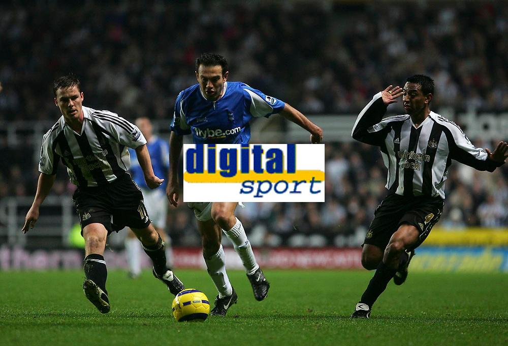 Photo: Andrew Unwin.<br />Newcastle Utd v Birmingham City. The Barclays Premiership. 05/11/2005.<br />Newcastle's Scott Parker (L) and Nolberto Solano (R) give chase to Birmingham's Stan Lazaridis (C).