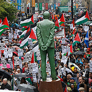 A demonstration in Glasgow's Buchanan Street beside the statue of late Scottish Labour leader Donald Dewar, to protest about the situation in Palestine. Pro Palestine demo. Anti Israel.  Picture Robert Perry 18th July 2014<br /> <br /> Must credit photo to Robert Perry<br /> FEE PAYABLE FOR REPRO USE<br /> FEE PAYABLE FOR ALL INTERNET USE<br /> www.robertperry.co.uk<br /> NB -This image is not to be distributed without the prior consent of the copyright holder.<br /> in using this image you agree to abide by terms and conditions as stated in this caption.<br /> All monies payable to Robert Perry<br /> <br /> (PLEASE DO NOT REMOVE THIS CAPTION)<br /> This image is intended for Editorial use (e.g. news). Any commercial or promotional use requires additional clearance. <br /> Copyright 2014 All rights protected.<br /> first use only<br /> contact details<br /> Robert Perry     <br /> 07702 631 477<br /> robertperryphotos@gmail.com<br /> no internet usage without prior consent.         <br /> Robert Perry reserves the right to pursue unauthorised use of this image . If you violate my intellectual property you may be liable for  damages, loss of income, and profits you derive from the use of this image.