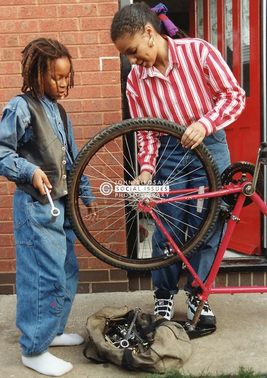 Mending a child's bike, UK 1980s
