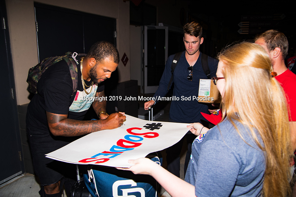 Amarillo Sod Poodles pitcher Jordan Gerrero (40) signs autographs during the homecoming celebration after the Sod Poodles won the Texas League Championship early on Monday, Sept. 16, 2019, at HODGETOWN in Amarillo, Texas. [Photo by John Moore/Amarillo Sod Poodles]