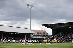 Fulham and Sheffield Wednesday players observe a minute's applause for the Barcelona attack.