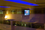 TV news on screen in luxury room at hotel chain Sofitel at Heathrow Airport's Terminal 5.