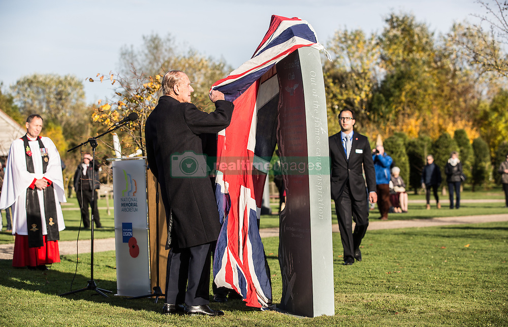 The Duke of Edinburgh, President, the Guinea Pig Club unveils the new memorial to those airmen saved after being burned in their aircraft at the National Memorial Arboretum, Staffordshire.