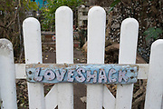 Eccentric and ecclectic Love Shack gate on Eel Pie Island in London, England, United Kingdom. Eel Pie Island is a small island in the River Thames at Twickenham in the London Borough of Richmond upon Thames and is only accessible by boat or by footbridge. The island has about 50 homes, 120 inhabitants, two or three boatyards as well as some other small businesses and artists studios. It has nature reserves at either end, protected from public access.