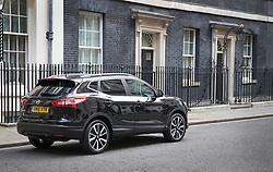 © Licensed to London News Pictures. 14/10/2016. London, UK. Nissan Chairman and CEO Carlos Ghosn arrives in Downing in a Nissan Qashqai car for talks with Prime Minister Theresa May. Mr Ghosn ha stated that he would like a government pledge to  compensate Nissan for any tariffs that may be imposed after the UK leaves the EU. Photo credit: Peter Macdiarmid/LNP