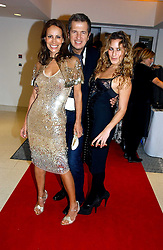 Left to right, ANDREA DELLAL, MARIO TESTINO and CHARLOTTE DELLAL at a party to celebrate the 90th birthday of Vogue magazine held at The Serpentine Gallery, Kensington Gardens, London on 8th November 2006.<br /><br />NON EXCLUSIVE - WORLD RIGHTS