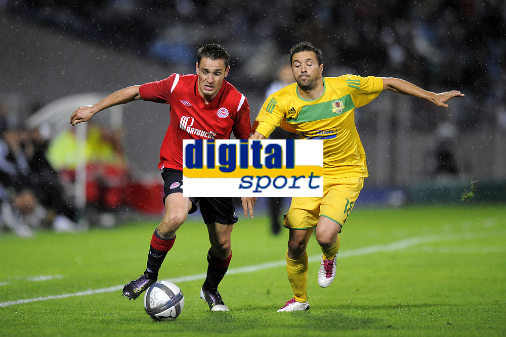 FOOTBALL - UEFA EUROPA LEAGUE 2010/2011 - PLAY OFF - 2ND LEG - LILLE OSC v FC VASLUI - 26/08/2010 - PHOTO JEAN MARIE HERVIO / DPPI - MATHIEU DEBUCHY (LOSC) / LUCIAN SANMARTEAN (FCV)
