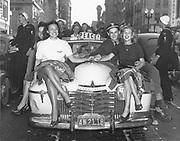 OPS_22-TT05.  End of the war parade on SW Broadway. V-J Day. Oregon Journal newspaper on dashboard.