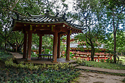 """Meditation gazebo. The peaceful Byodo-In Temple is in Valley of the Temples Memorial Park, at 47-200 Kahekili Highway, Kaneohe, on the island of Oahu, Hawaii, USA. The Byodo-In Temple (""""Temple of Equality"""") was built in 1968 to commemorate the 100 year anniversary of the first Japanese immigrants to Hawaii. This Hawaii State Landmark is a non-practicing Buddhist temple which welcomes people of all faiths. Byodo-In Temple in O'ahu is a half-scale replica of the original Byodo-in Temple built in 1053 in Uji, Japan (a UNESCO World Heritage Site)."""