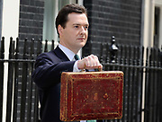 "Britain's Chancellor of the Exchequer George Osborne MP stands outside No 11 Downing St. before going to the House of Commons to deliver his first Budget. In a statement released the Chancellor said: ""My budget is tough but it will be fair."""