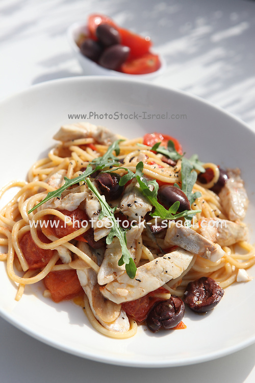 Spaghetti with fish and olives