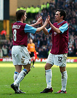 Photo. Matthew Lewis.<br /> Wolverhampton Wanderers v West Ham United. FA Cup 4th Round. 25/01/2004.<br /> <br /> West Hams' Matthew Etherigton congratulates his team mate David Connolly on his goal against Wolves.