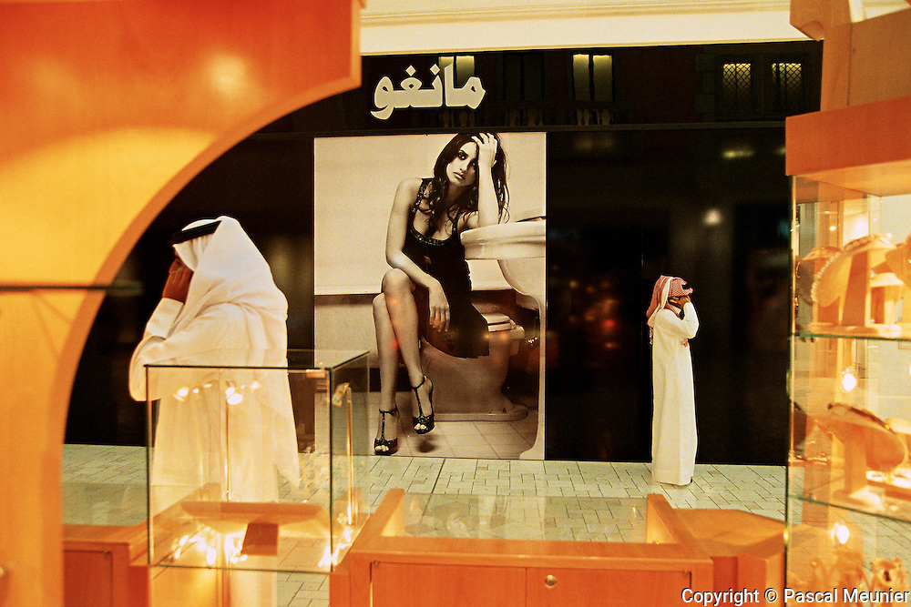 QATAR. Doha. Modern bedouins...In this Wahhabit country, the inhabitants take the good sides of modernity (malls or mobile phones which facilitated the life) but turn their backs to the excesses of Occident. Here one remains attached to Bedouin roots and the precepts of Islam..