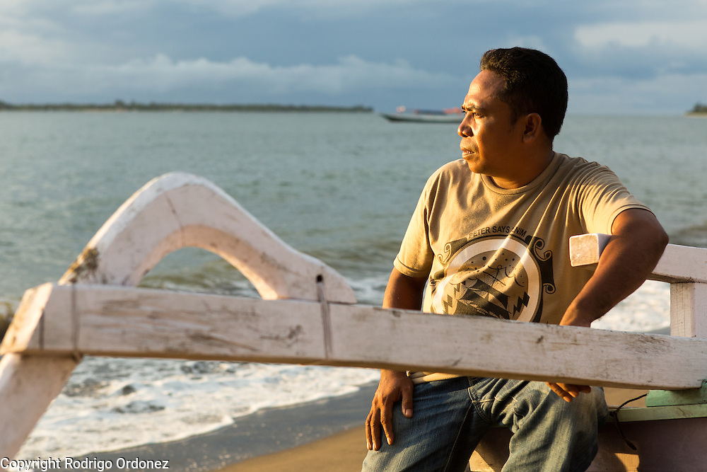 Sriyudin, 41, looks at the sea in Muara Putat beach, Pemenang Timur, Pemenang subdistrict, North Lombok district, West Nusa Tenggara province, Indonesia. He is a fisherman and also the head of the subvillage. Last January (2013) a tidal wave hit the beach and flooded the land, including his rice paddy of 1.5 hectares which became infertile.