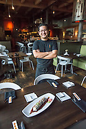 Chef Fumi Nagase proudly displays his Streetcar Sushi