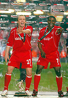 Photo: Scott Heavey.<br /> Middlesbrough v Bolton Wanderers. Carling Cup Final. 29/02/2004.<br /> Bolo Zenden (L) and George Boateng celebrate the win