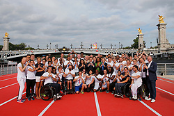 French President Emmanuel Macron (C) stands with city mayor Anne Hidalgo (C Left) and Sports Minister Laura Flessel (C Right) as they pose with athletes for a family photo on an athletics track which floats on the Seine River in Paris, France, June 24, 2017. The French capital is transformed into a giant Olympic park to celebrate International Olympic Days with a variety of sporting events for the public across the city during two days as the city bids to host the 2024 Olympic and Paralympic Games. Photo by Jean-Paul Pelissier/Pool/ABACAPRESS.COM