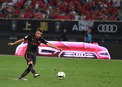 SHANGHAI, July 19, 2017  Aaron Ramsey of Arsenal kicks a penalty during the match between Arsenal and Bayern Munich of 2017 International Champions Cup China in Shanghai, China, July 19, 2017. (Credit Image: © Jia Yuchen/Xinhua via ZUMA Wire)