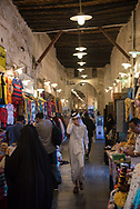 Shoppers and shopkeepers at night in Souk Waqif, a popular pedestrian area in Doha, Qatar
