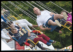 June 11, 2017 - Westonbirt, United Kingdom - Image licensed to i-Images Picture Agency. 11/06/2017. Westonbirt, United Kingdom. Mike Tindall has a go on a swing ride  with his daughter Mia ( bottom left) at the Gloucestershire Festival of Polo at Beaufort Polo Club in Westonbirt, Gloucestershire, United Kingdom. Picture by Stephen Lock / i-Images (Credit Image: © Stephen Lock/i-Images via ZUMA Press)