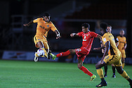 Joss Labadie of Newport county (l) is challenged by Oran Jackson of MK Dons. EFL cup, 1st round match, Newport county v Milton Keynes Dons at Rodney Parade in Newport, South Wales on Tuesday 9th August 2016.<br /> pic by Andrew Orchard, Andrew Orchard sports photography.
