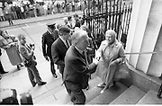 Mass For The 26th Dail.     (T3)..1989..29.06.1989..06.29.1989..29th June 1989..After the General Election  a mass took place today at the Pro-Cathedral in Dublin. The mass was to bless   the incoming TD's who were successful in their election to the Dáil...Image shows An Taoiseach, Charles Haughey TD, at the Pro-Cathedral taking time to speak to the waiting media.