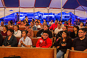 "12 JULY 2012 - FT DEFIANCE, AZ: At the 23rd annual Navajo Nation Camp Meeting in Ft. Defiance, north of Window Rock, AZ, on the Navajo reservation. Preachers from across the Navajo Nation, and the western US, come to Navajo Nation Camp Meeting to preach an evangelical form of Christianity. Evangelical Christians make up a growing part of the reservation - there are now more than a hundred camp meetings and tent revivals on the reservation every year. The camp meeting in Ft. Defiance draws nearly 200 people each night of its six day run. Many of the attendees convert to evangelical Christianity from traditional Navajo beliefs, Catholicism or Mormonism. ""Camp meetings"" are a form of Protestant Christian religious services originating in Britain and once common in rural parts of the United States. People would travel a great distance to a particular site to camp out, listen to itinerant preachers, and pray. This suited the rural life, before cars and highways were common, because rural areas often lacked traditional churches.PHOTO BY JACK KURTZ"