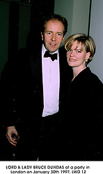 LORD & LADY BRUCE DUNDAS at a party in London on January 30th 1997.LWD 12