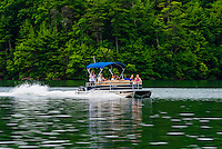A pontoon boat on Philpott Lake, near Roanoke, Virginia USA.