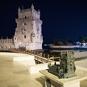LISBON, Portugal -- Built on a small island near the banks of the Tagus River just to the southwest of downtown Lisbon, the Tower of Belem (or Torre de Belém) dates to 1514-1520. It was part of a defensive network protecting shipping to Lisbon port and beyond during Portugal's Age of Discovery. Paired with the nearby Jerónimos Monastery it is listed as a UNESCO World Heritage Site. In the foreground is a replica at 1:50 scale designed to aid the visually impaired.