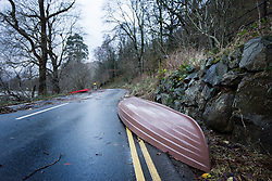 © Licensed to London News Pictures. 08/12/2015. Glen ridding UK. Picture shows a boat in the road on the way into Glenridding. The village of Glenridding has been cut of from the outside world for four days with no water, electricity or telephone lines after huge torrents of water from the surrounding mountains destroyed roads leading to it & flooded the village centre. Photo credit: Andrew McCaren/LNP