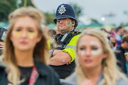Police and fans watch on - as Katy Perry plays the Pyramid Stage - The 2017 Glastonbury Festival, Worthy Farm. Glastonbury, 24 June 2017