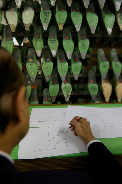 Fashion designer Jimmy Choo draws in his studio on Cannaught Street, London, March 22, 2010