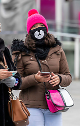 © Licensed to London News Pictures. 31/01/2020. London, UK. A young women wears a protective mask at the London Eye, South Bank this morning as two patients are confirmed to have the Coronavirus in the UK. Photo credit: Alex Lentati/LNP