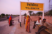 Tiloniya Railway Station nearby Tilonia Barefoot College...Barefoot College Tilonia, started by Bunker Roy in the 1970s. An organisation based upon creating economic self-empowerment and sustainable development initiatives, and self-sufficiency, for communities in the rural desert of Rajasthan, India. Energy autonomy with solar power capacitors, parabolic mirrors for cooking, solar powered water heating, and battery lanterns. Freshwater and irrigation through wells and desalination. A multitude of other economic initiatives run by grassroots Indian people, mainly women, where those who participate in, run the projects themselves. Many of them local lower castes, some physically handicapped, most with no paper qualifications, with support from others who gave up high flying money-making careers to be involved in working with poor rural communities. Mico-industries include solar lanterns, electric circuitry and lighting, crafts, textiles, children's toys, and sanitary towels. Also much emphasis on local and oral communications, radio, and puppetry. Now recognised internationally providing an educational resource most often directed towards communities of rural women worldwide.