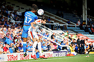 Peterborough United forward Ivan Toney (17) is strong in this header during  the EFL Sky Bet League 1 match between Peterborough United and Luton Town at London Road, Peterborough, England on 18 August 2018.