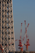 Cranes at the Tokyo Skytree  construction site. Oshiage, Tokyo, Japan. Friday February 4th 2011. When finished this telecommunications tower will measure 634 metres from top to bottom making it the tallest structure in East Asia..