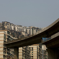 Chongqing is a city of massive building developments. The Shanhu Changjiang Bridge is one such project. It spans the Yangtze River and is connected to an elegant network of new highways, which cut through the old construction of the city, photographed on Tuesday 20 March 2007.